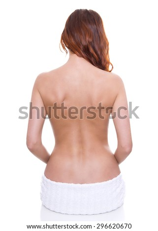 back of beautiful young woman with red hair isolated on white