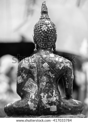 Back of Buddha statue in Black and white - stock photo