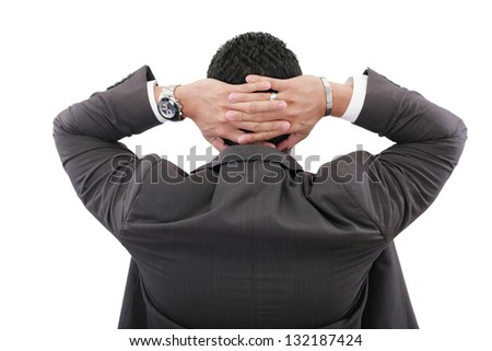 back of businessman holding hands on head on white background