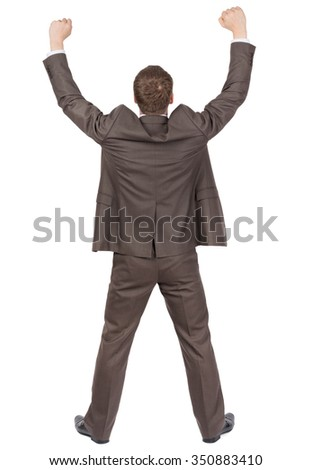 Back of businessman thumbs up, rear view. Isolated over white  - stock photo