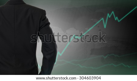 Back of  Businessman with investment graph  - stock photo