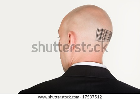 Back of male head slightly turning with barcode - stock photo