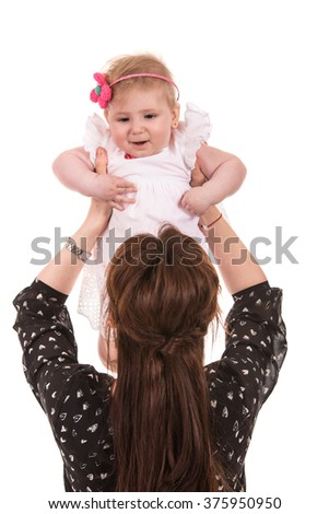Back of mother raising her baby girl isolated on white background