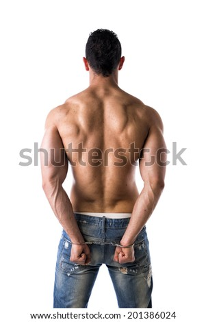 Back of muscular shirtless young man with handcuffs, isolated on white - stock photo