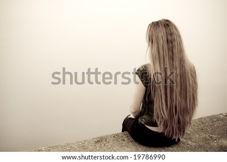 Back of suicidal depressed young woman - stock photo