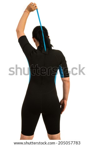 Back of surfer woman closing the zipper to neoprene suit isolated on white background