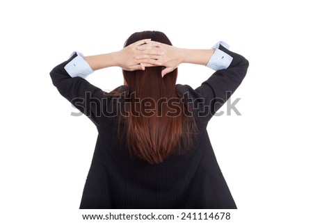 Back of young Asian businesswoman with hands on her head  isolated on white background
