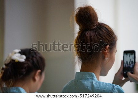 back   part  of  hair  style   in  Thai  northern  lady.