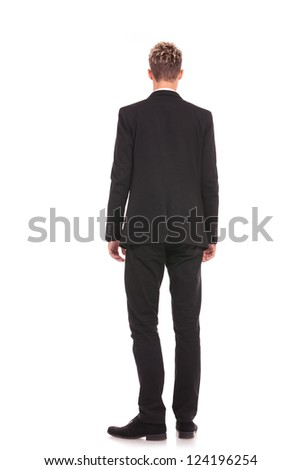 back picture of a young business man looking away on white background