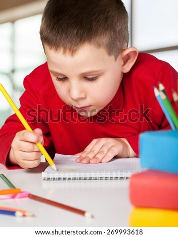 Back. Portrait of lovely girls drawing at workplace with schoolboys on background - stock photo