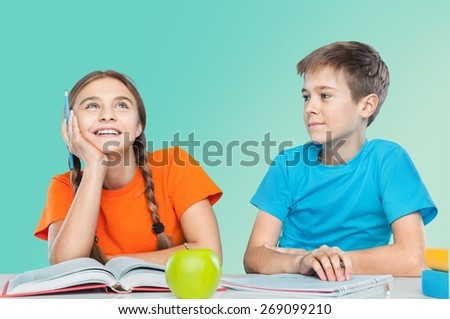 Back. Portrait of two diligent pupils interacting while drawing at lesson - stock photo