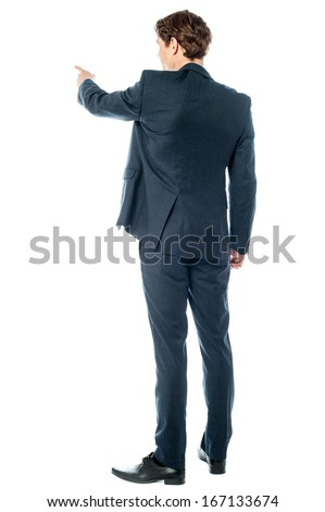 Back pose of a casual businessman pointing