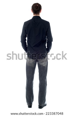 Back pose of a casual young man over white - stock photo