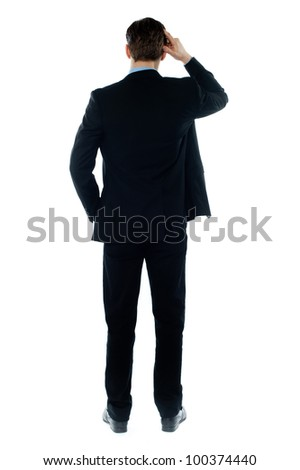 Back-pose of a corporate person thinking hard isolated over white background - stock photo