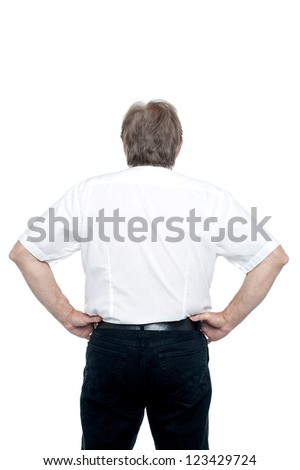 Back pose of a senior man standing with hands on his waist. All on white background. - stock photo