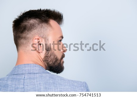 Back rear view of confident handsome brunet in smart casual, standing on the pure light blue background, with perfect hairstyle. So hot and attractive, harsh and fashionable