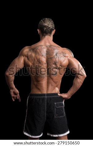 Back Rear View Tattooed Male On Isolated Black Background - stock photo