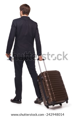 Back shot of business traveler leaving with his luggage, isolated on white background - stock photo