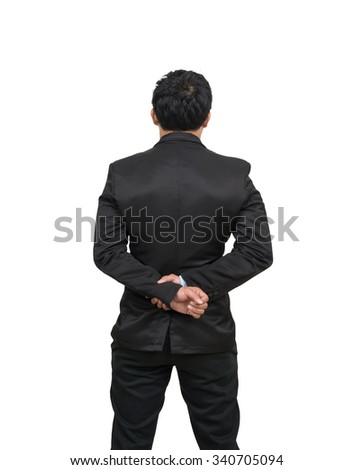 Back side of a businessman with his hands clasped behind himself, Include clipping path - stock photo