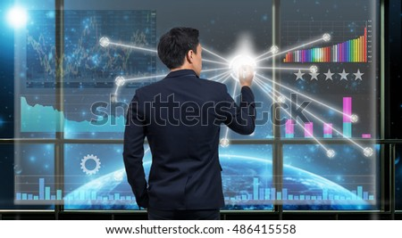Back side of Businessman drawing the Technical information over the virtual screen on the Part of earth network line background out off window,Elements of this image furnished by NASA,Business concept