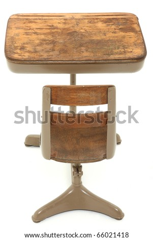 Back side of old single student school desk over white background. - stock photo
