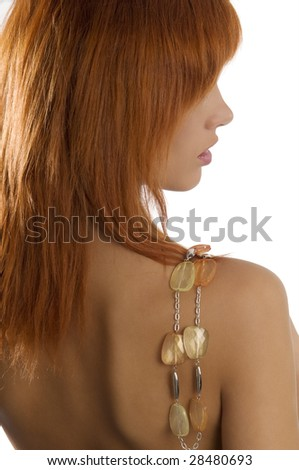back side shot of young and beautiful red haired with stones necklace on shoulder