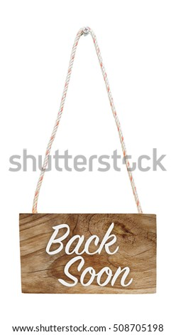 Back soon on hanging wooden sign, isolated, with clipping path
