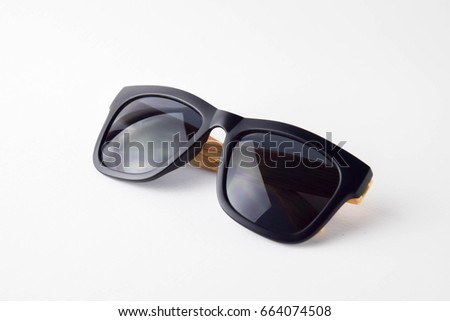 back sun glasses wooden legs on white background