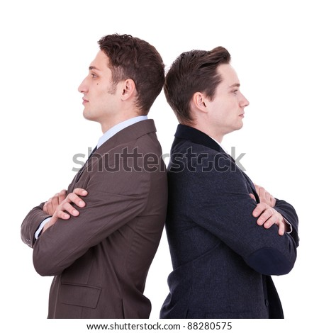 back to back businessmen looking away from the camera over white background - stock photo