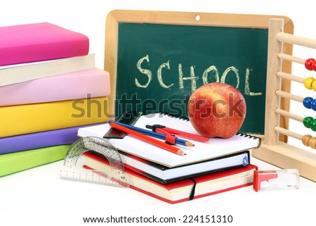back to school-abacus, notebooks, pencil and apple over chalkboard  - stock photo