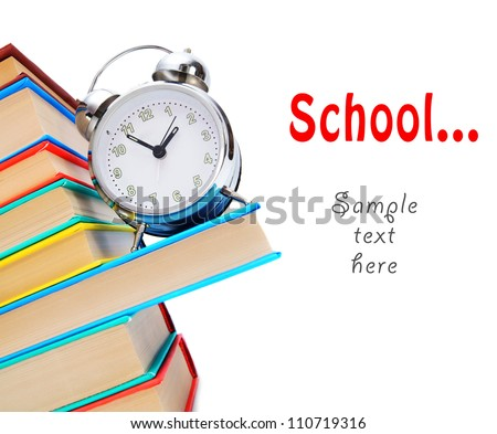 Back to school. An alarm clock and books.