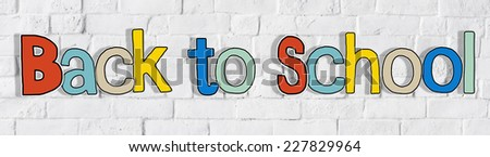 Back to School and Brick Wall in the Background - stock photo