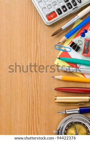 back to school and office supplies on wood background - stock photo