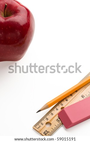 Back to school. Apple,pencil,ruler and eraser on white background with copy space. - stock photo