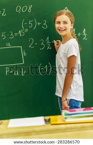 Back to school - beautiful girl on math lesson - stock photo