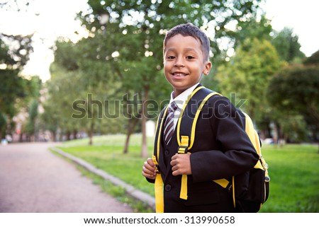 Back to school. Boy from elementary school at the school yard.  - stock photo
