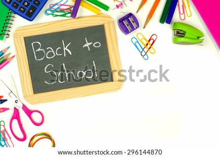 Back to School chalkboard on a white background with school supplies corner border - stock photo