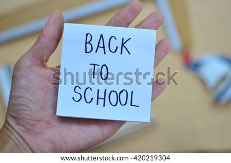 back to school,Close up school supplies on wooden floor