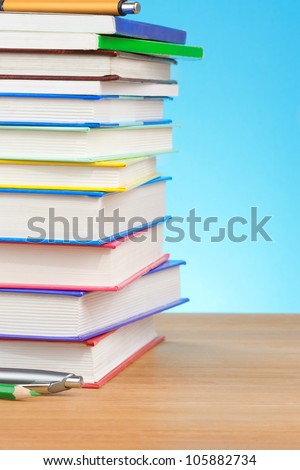 back to school concept and book  on blue background - stock photo