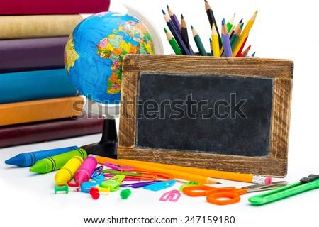 back to school concept, blank blackboard with school supplies - stock photo