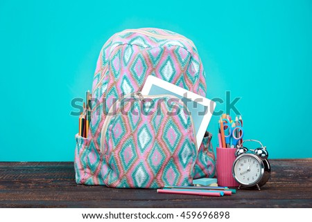 Back to School concept. Books, colored pencils and backpack - stock photo