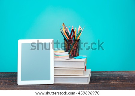 Back to School concept. Books, colored pencils and laptop - stock photo