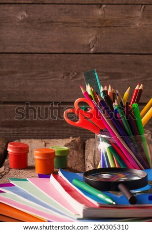 Back to school concept on wooden background