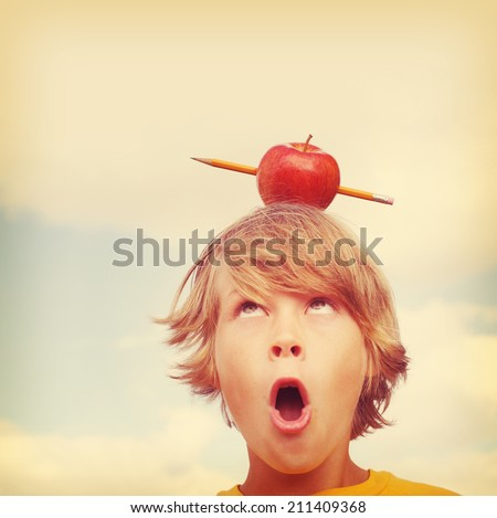 Back to school concept, pencil shooting through an apple.  Instagram effect - stock photo