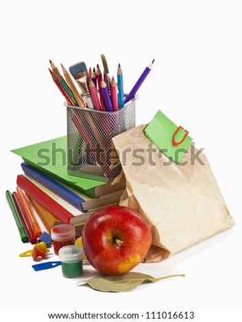 Back to School concept.School Books and  apple isolated on white