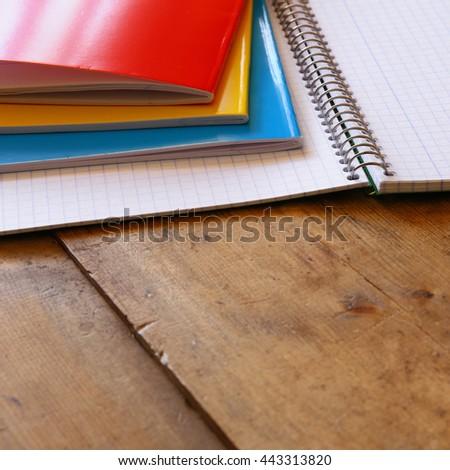 Back to school concept. School notebook on wooden desk. selective focus - stock photo