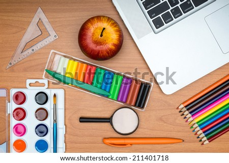 Back to School concept .  School supplies on wooden school desk from above - stock photo