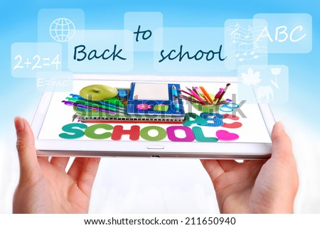 back to school concept with hands holding tablet pc displaying school staffs and text - stock photo