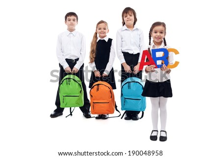 Back to school concept with kids holding colorful schoolbags - isolated - stock photo