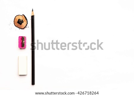 back to school.Drawing supplies: assorted color pencils, isolated on white background.Books and blackboard,School and office supplies on wood background. Back to school. - stock photo